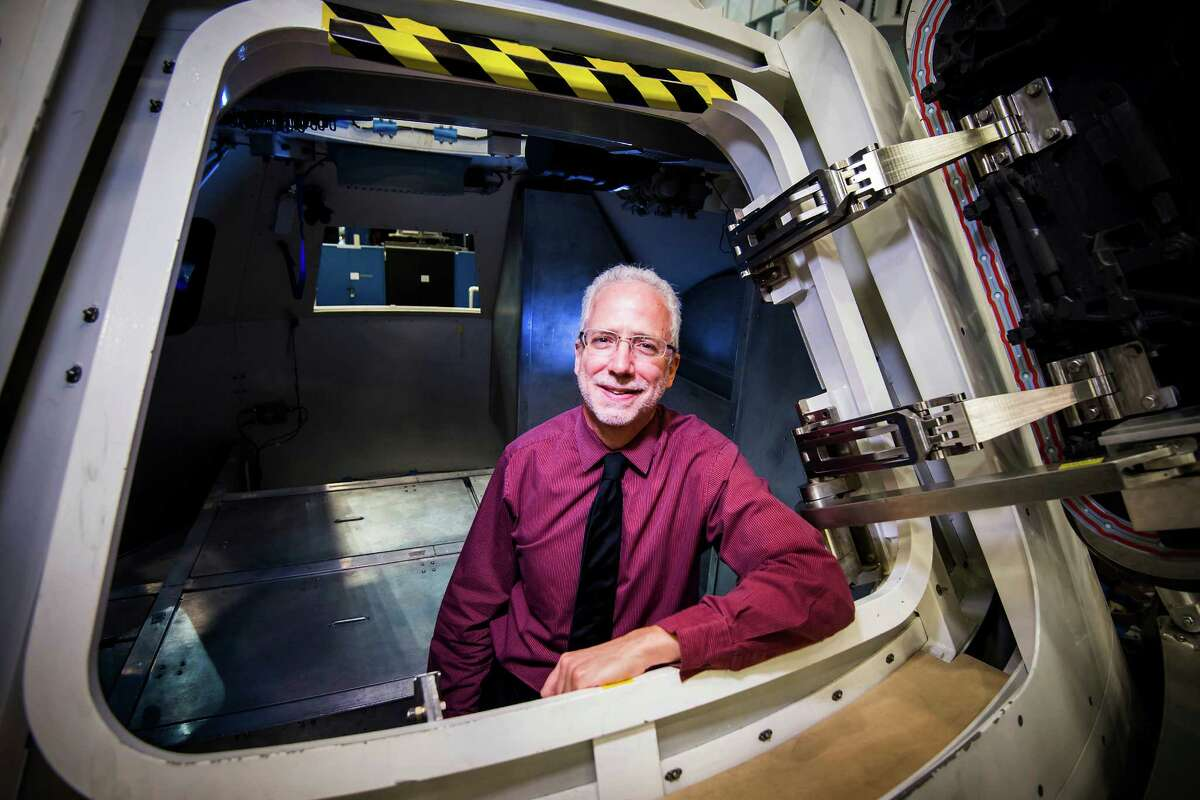 NASA Orion Program Manager Mark Geyer photographed in a mockup of the spacecraft at the NASA Johnson Space Center Thursday, March 27, 2014, in Houston.