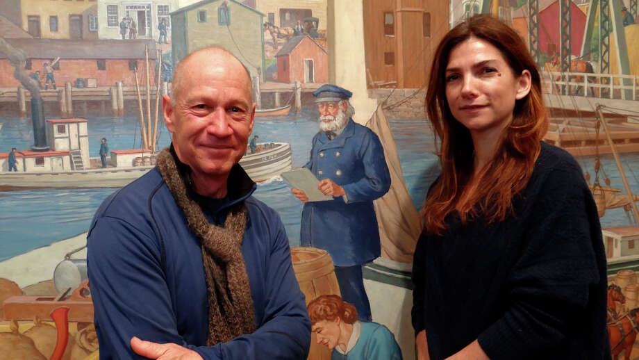 """Brad Kellogg of Fairfield and Katherine Daught Jacob of Weston are descendants of Capt. Sereno Gould Allen, a prominent Saugatuck citizen in the 1800s, pictured in the mural behind them, on display at tthe Westport Historical Society's new exhibit, """"Saugatuck @ Work."""" Photo: Mike Lauterborn / Westport News"""