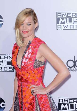 Elizabeth Banks' lipstick matches her bright dress a little too well. Photo: C Flanigan, Getty Images / 2014 C Flanigan