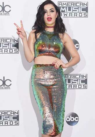 ...then switches to crazy disco mermaid in the press room. Photo: Image Group LA, GettyImages / © 2014 American Broadcasting Companies, Inc. All rights reserved.