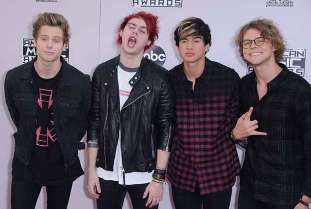 The boys of 5 Seconds to Summer are incapable of taking a photo without one of them making a stupid face. Photo: C Flanigan, GettyImages / 2014 C Flanigan