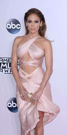 Jennifer Lopez has once again mastered the art of twisting strips of fabric into a masterpiece made for the sexiest baton twirler at the red carpet parade. Photo: C Flanigan, Getty Images / 2014 C Flanigan