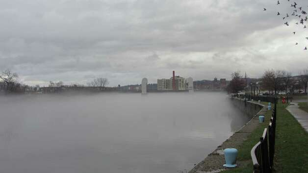 Fog rises from the Hudson River on Monday. Forecasters say the temperature in Albany could rise into the 60s on Monday but the mercury will drop dramatically through the week and the region could be hit with heavy snow on Wednesday. (Bob Gardinier / Times Union)