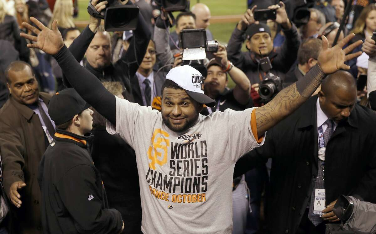 San Francisco Giants' Pablo Sandoval celebrates after Game 7 of baseball's World Series against the Kansas City Royals Wednesday, Oct. 29, 2014, in Kansas City, Mo. The Giants won 3-2 to win the series.