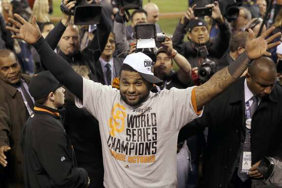 San Francisco Giants' Pablo Sandoval   celebrates after Game 7 of baseball's World Series against the Kansas City Royals Wednesday, Oct. 29, 2014, in Kansas City, Mo. The Giants won 3-2 to win the series. (AP Photo/Matt Slocum)
