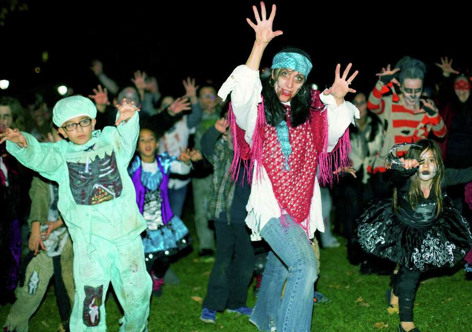 Thriller Flash Mob enjoys the spotlight during New Milford Parks & Recreation's Halloween Trunk or Treat in the village center, Oct. 31, 2014. Photo: Trish Haldin / The News-Times Freelance
