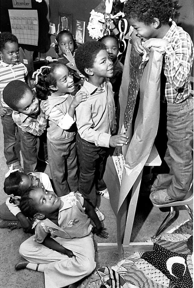Blanchette Elementary students look at a stocking filled with the money they raised for EJ in 1983. Enterprise file photo