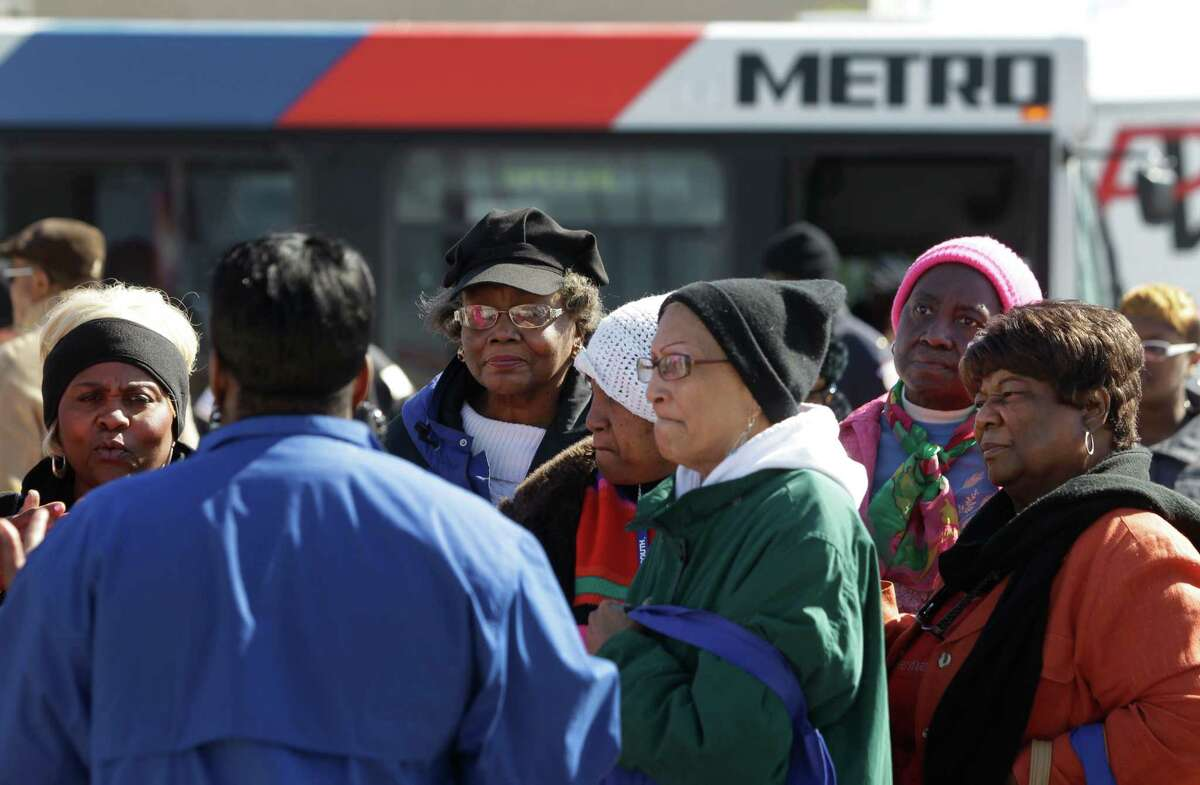 A group listens to Tonya Lawson, a METRO mobility coordinator, during a tour at the Roberson/UH/TSU rail station as part of a Third Ward Community Center program Nov. 18. The event included a bus tour to the Southeast Transit Center and Roberson/UH/TSU rail station.