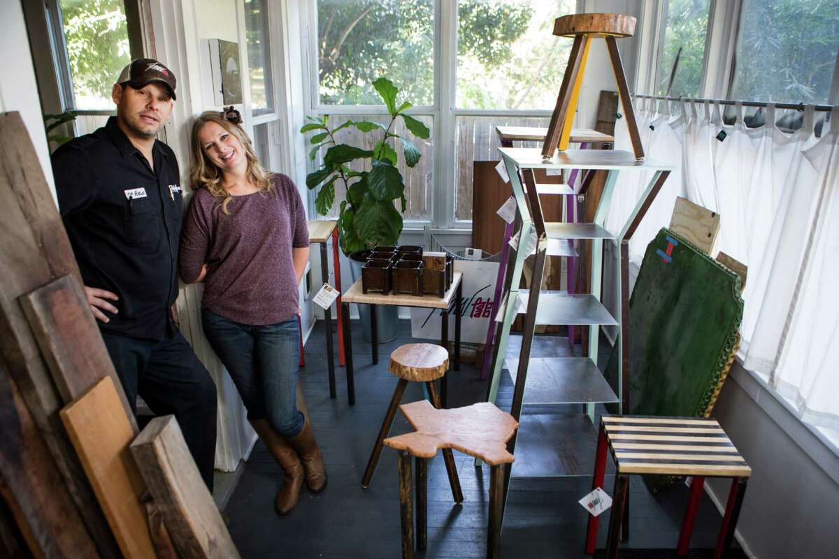 Hillary and Ford Waters pose for a portrait with samples of their work on Wednesday, Nov. 19, 2014, in Houston. The husband and wife team form FMW Fab Lab, who design and other decorative metal pieces. The couple will be among the more than 100 vendors at a Black Friday Holiday Pop Shop at Silver Street Studios. ( Brett Coomer / Houston Chronicle )