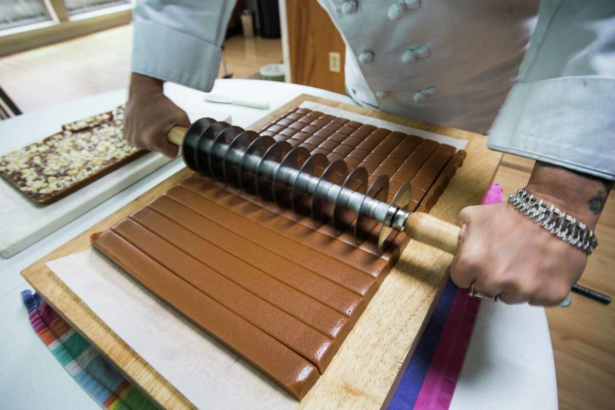 Baranna Baker cuts up Tahitian vanilla caramels on Wednesday, Nov. 19, 2014, in Houston. Baker, who runs Hungry Birds Eat Sweet, her home-based business that makes various sweets. She will be among the more than 100 vendors at a Black Friday Holiday Pop Shop at Silver Street Studios. ( Brett Coomer / Houston Chronicle )