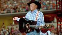 You could own a guitar signed by George Strait - Photo