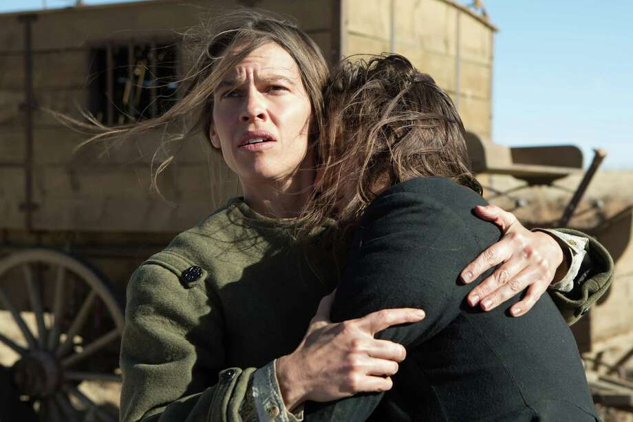 """Hilary Swank takes on a risky mission across the Plains in """"The Homesman."""" Photo: Dawn Jones, HO / Roadside Attractions"""