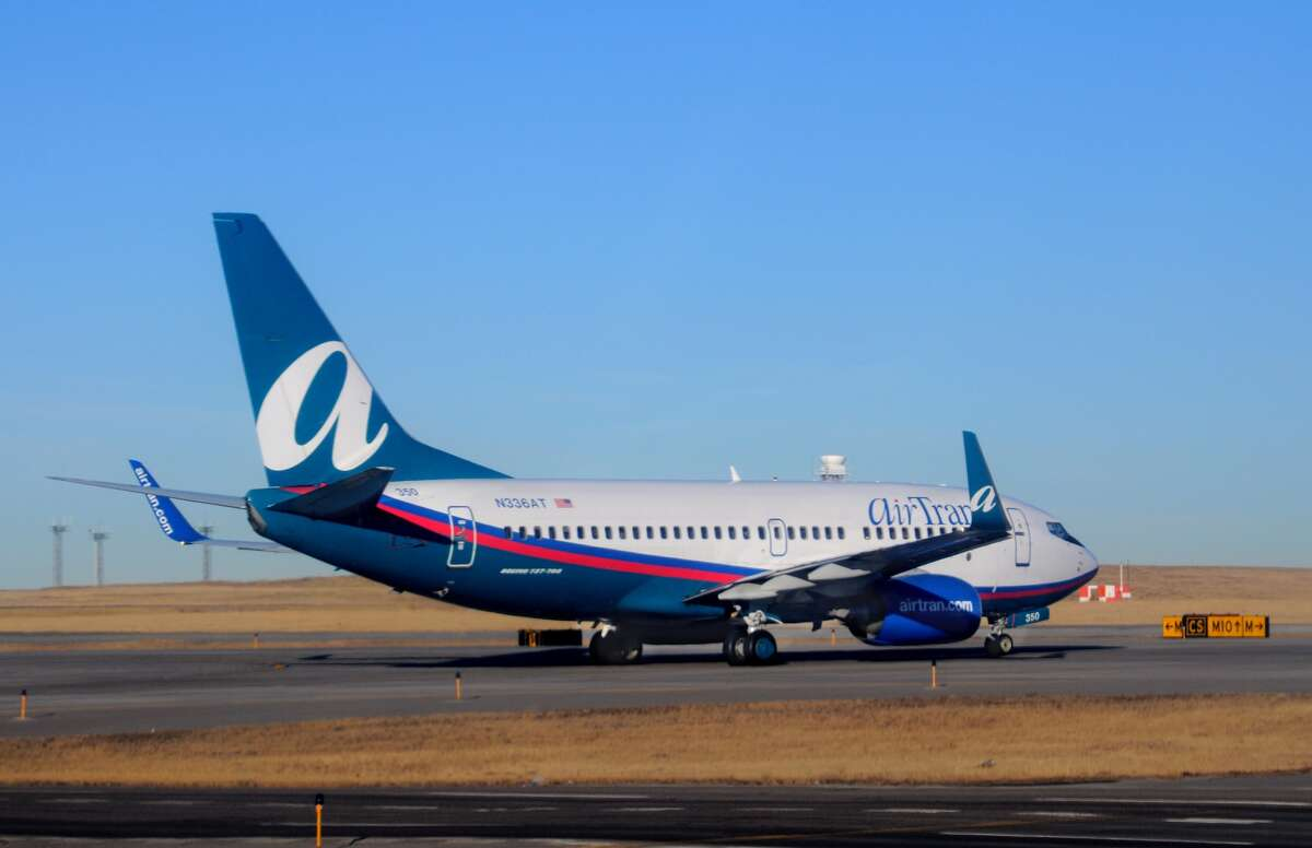 Airline: AirTran (2014)Carry-on bag: $01st checked bag: $252nd checked bag: $35Additional bags: $75 bags 3+Overweight bags: $75 if 50 to 100 poundsOversized bags: $75 if 63 to 80 inchesTicket change fee: $150 or $50 if same dayBooking fees: $15 on phone or $50 in personUnaccompanied minors: $50Pets: $95 (cabin)Seat selection: $10 to $30Premium seat perks: $10 priority boardingIn-flight food/beverages: $0 for food and $5 to $6 for alcoholic beveragesBlankets/pillows: N/A