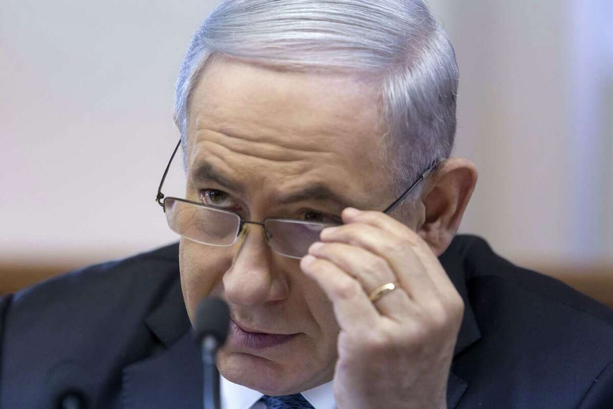 Israeli Prime Minister Benjamin Netanyahu chairs the weekly Cabinet meeting at his Jerusalem office.