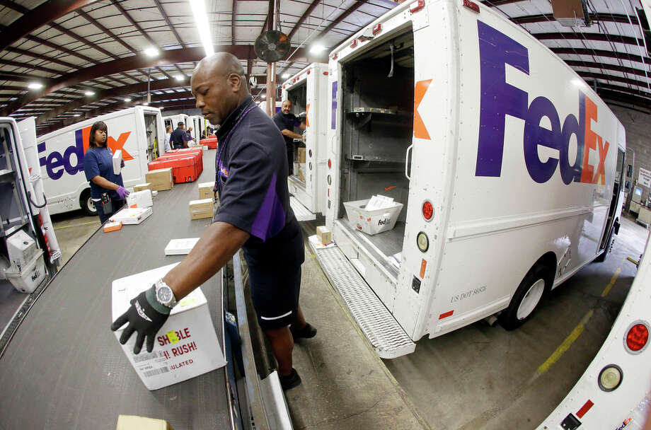 FedEx argues that it was not aware it was delivering drugs bought online without prescriptions, but a federal judge refused to dismiss the case. Photo: Mark Humphrey / Mark Humphrey / Associated Press 2014 / AP