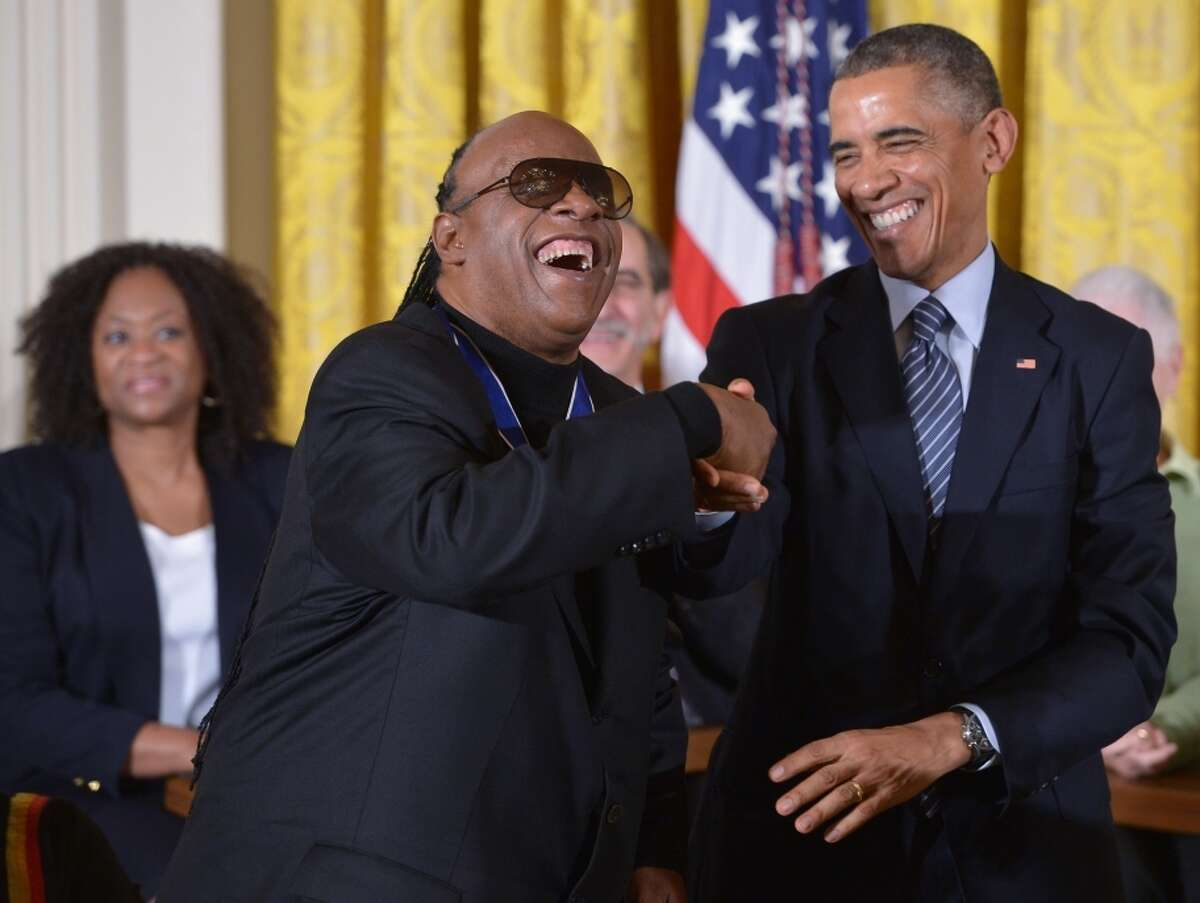 US President Barack Obama congratulates Medal of Freedom recipient Stevie Wonder (L) during a ceremony in the East Room of the White House on November 24, 2014 in Washington, DC. The Medal of Freedom is the country highest civilian honor. AFP PHOTO/Mandel NGANMANDEL NGAN/AFP/Getty Images