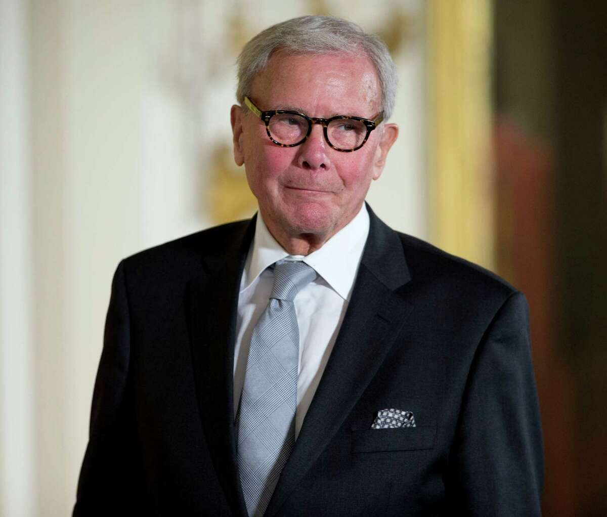 Journalist Tom Brokaw, is introduced before being awarded the Presidential Medal of Freedom, Monday, Nov. 24, 2014, during a ceremony in the East Room of the White House in Washington. President Obama is presenting the nation's highest civilian honor to 19 artists, activists, public servants and others. (AP Photo/Pablo Martinez Monsivais)