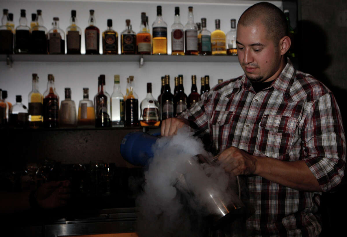 Bartender Jay Patrick Villafana gets ready to demonstrate the three-pronged stirrer with a Heidelberg Cup cocktail.
