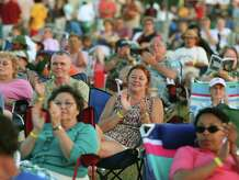 A summer audience enjoys a performance of The Litchfield Jazz Festival.