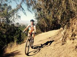Author Kristin Smith rides on one of the single-track trails at Joaquin Miller Park in Oakland. The 500-acre park offers something for every level of rider as well as killer views.