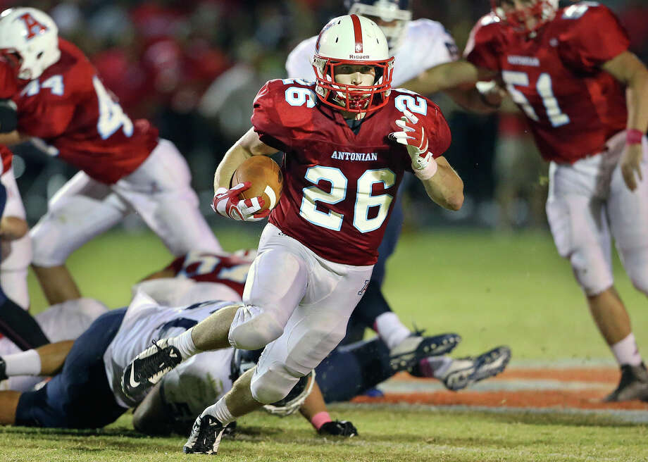 Apache running back Daniel Rosenfeld turns upfield after breaking through the line as Antonian hosts Central Catholic at Ferrara Stadium on Oct. 17, 2014. Photo: Tom Reel /San Antonio Express-News / San Antonio Express-News