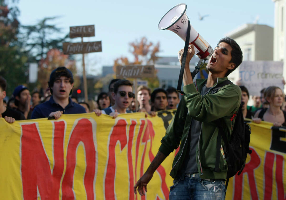 UC Berkeley student Awais Spall leads protesters who walked out of classes down the streets of Berkeley.