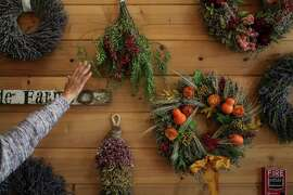 Wreaths and bundles of local flora cover the walls at family-owned Creekside Farms in Monterey County, now one of the largest wreath makers in the U.S.