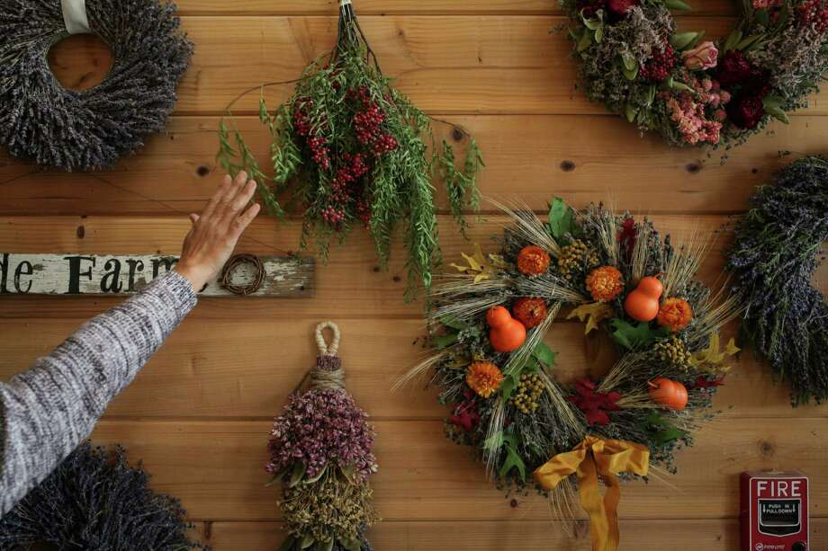 Wreaths and bundles of local flora cover the walls at family-owned Creekside Farms in Monterey County, now one of the largest wreath makers in the U.S. Photo: Sam Wolson / Special To The Chronicle / ONLINE_YES
