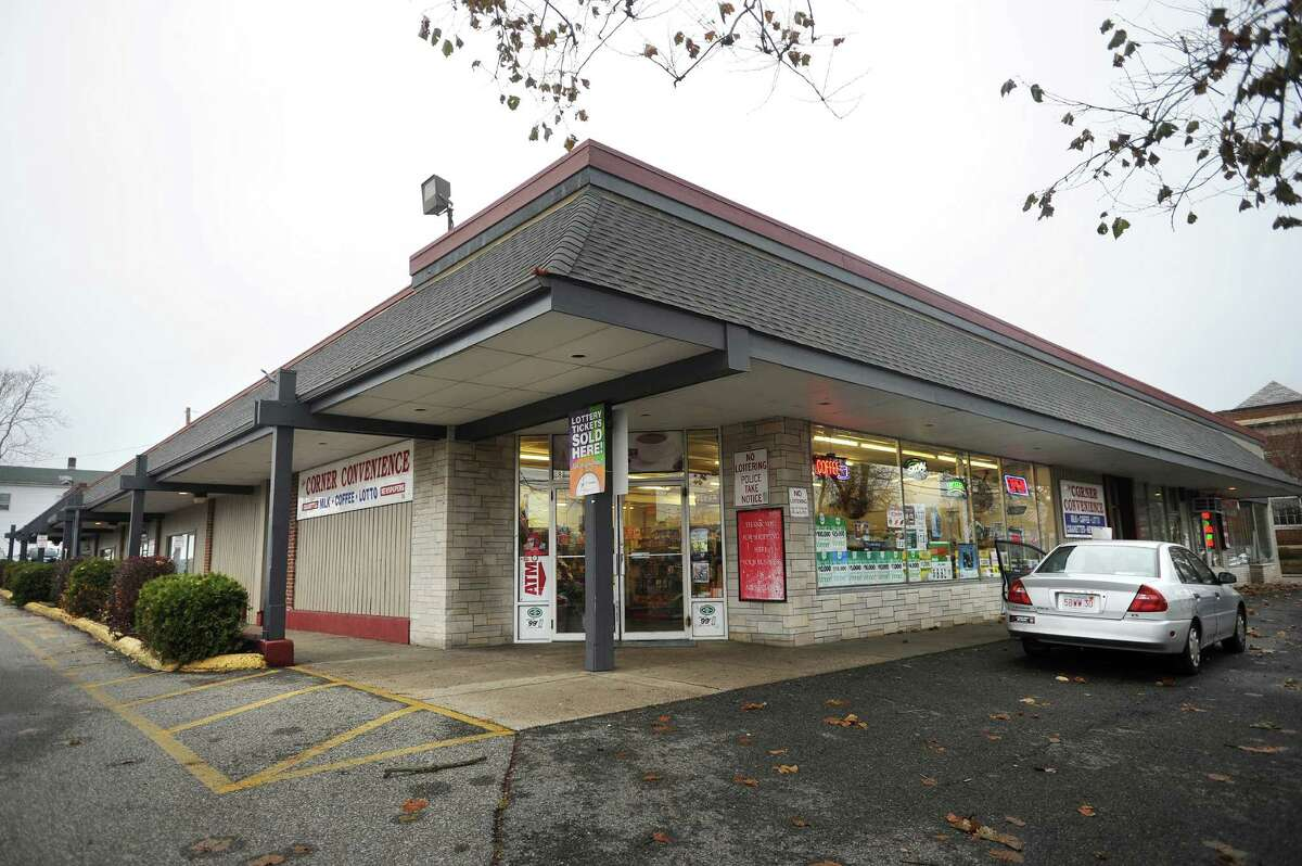The building housing Corner Convenience and adjoining parking lot, at 58 River Street in downtown Milford, Conn., is one of several properties the city plans to purchase to increase parking for the train station and downtown retailers on Monday, November 24, 2014.