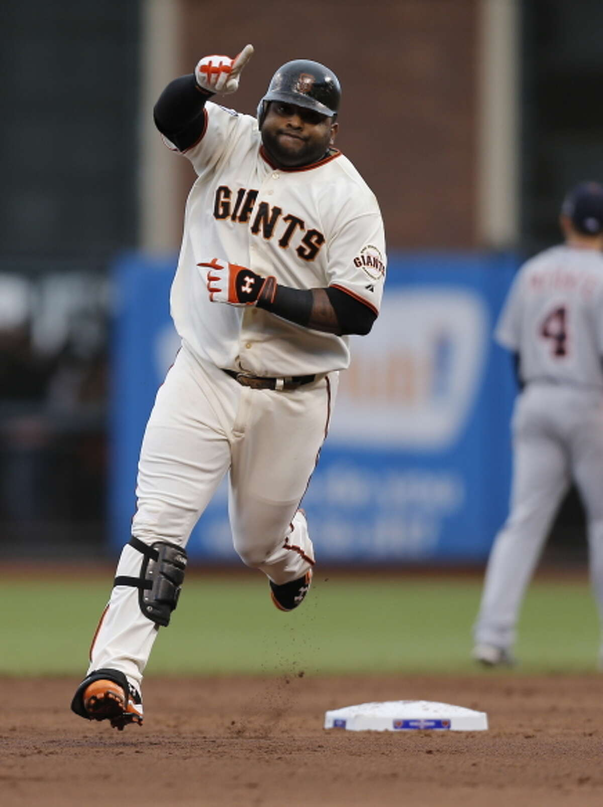 Giants' 3rd baseman Pablo Sandoval gestures as he rounds the bases after hitting his 1st inning homerun in game 1 of the NLCS at AT&T Park on Sunday, Oct. 14, 2012 in San Francisco, Calif.