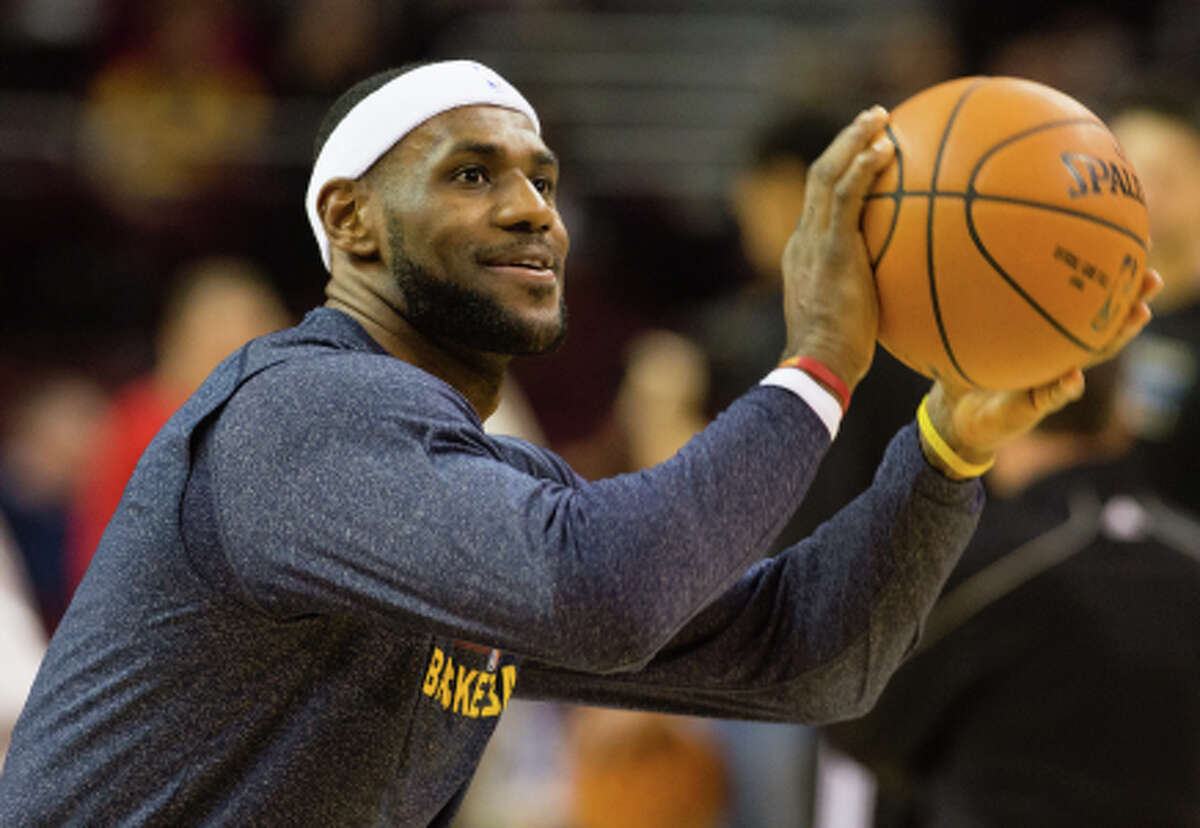 CLEVELAND, OH - NOVEMBER 24: LeBron James #23 of the Cleveland Cavaliers warms up prior to the game against the Orlando Magic at Quicken Loans Arena on November 24, 2014 in Cleveland, Ohio. NOTE TO USER: User expressly acknowledges and agrees that, by downloading and or using this photograph, User is consenting to the terms and conditions of the Getty Images License Agreement. (Photo by Jason Miller/Getty Images)
