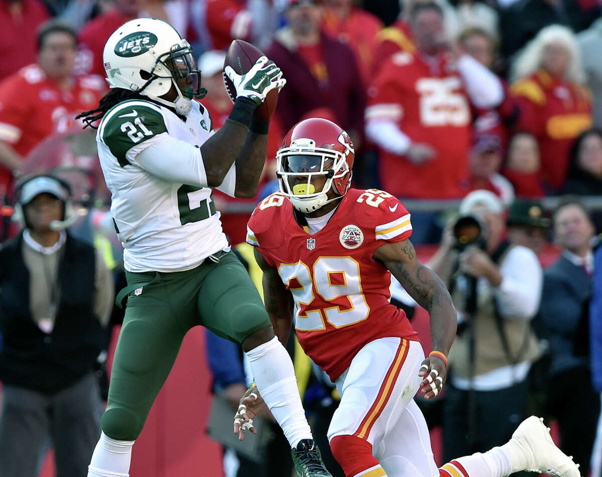 Safety Eric Berry (right) of the Chiefs, defending against the Jets' Chris Johnson, is undergoing tests for lymphoma.