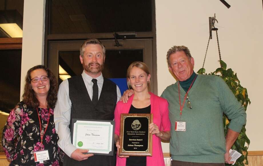 The New York State Outdoor Educators Association recently awarded Broadalbin resident Jolene Thompson, formerly of East Greenbush, its 2014 Service Award, recognizing her for her exemplary efforts to improve and support several key elements of the organization. From left, awards committee chair MaryLynne Malone; association president Tim Stanley; Thompson and awards committee member Marty Strong. (Photo by Eileen Beare)