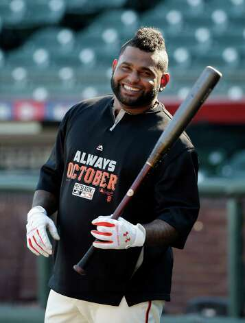 FILE - In this Oct. 18, 2014, file photo, San Francisco Giants third baseman Pablo Sandoval smiles as he takes batting practice during a team workout in San Francisco. Sandoval and the Boston Red Sox have agreed to a multiyear contract, a person with knowledge of the deal said. The person spoke to The Associated Press on condition of anonymity Monday, Nov. 24, 2014,  because the Red Sox had not announced the agreement. (AP Photo/Marcio Jose Sanchez, File) ORG XMIT: NY178 Photo: Marcio Jose Sanchez / AP