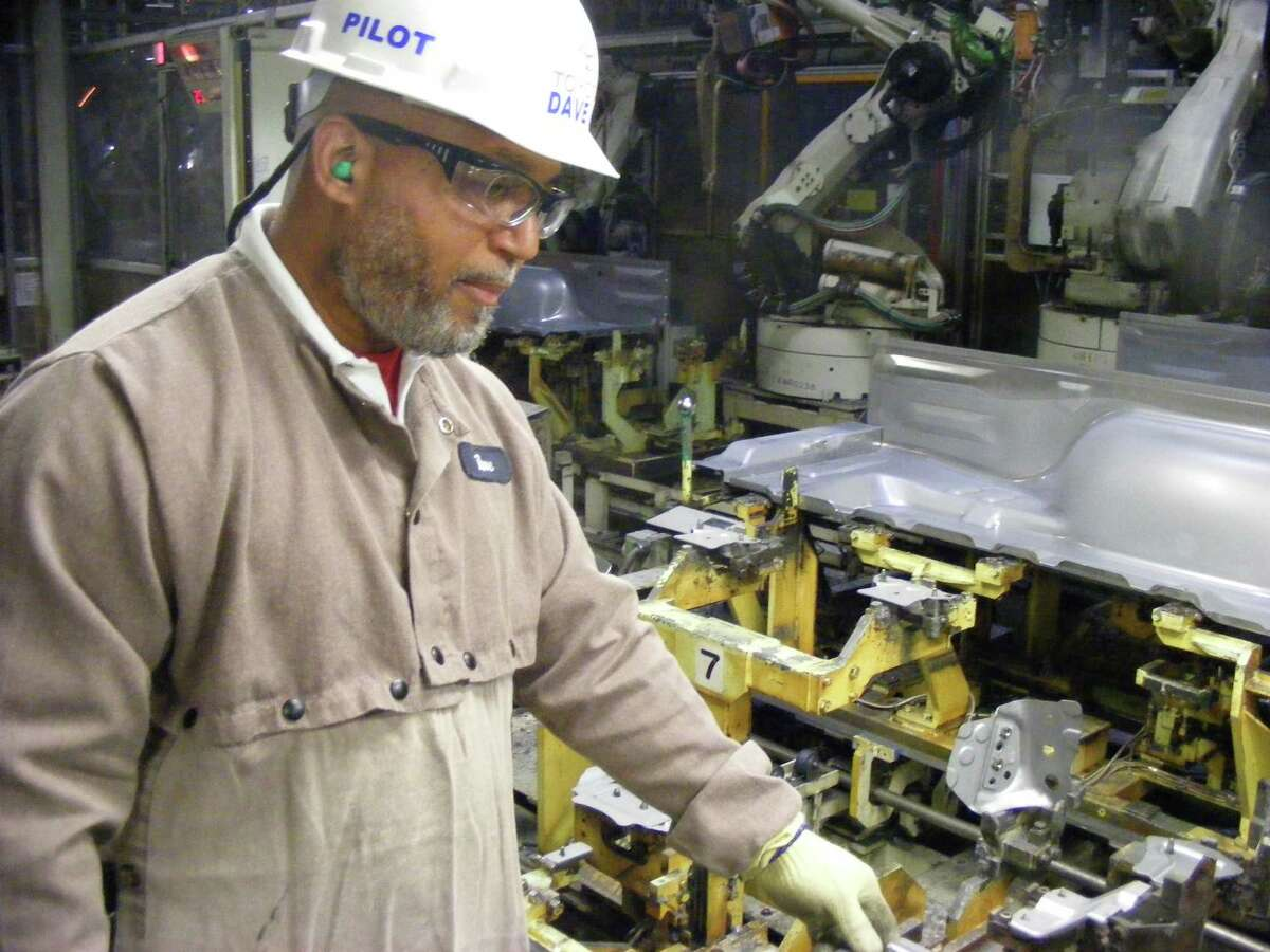 Air Force veteran Dave Henson tends to part of the production line at the Toyota Texas pickup assembly plant.