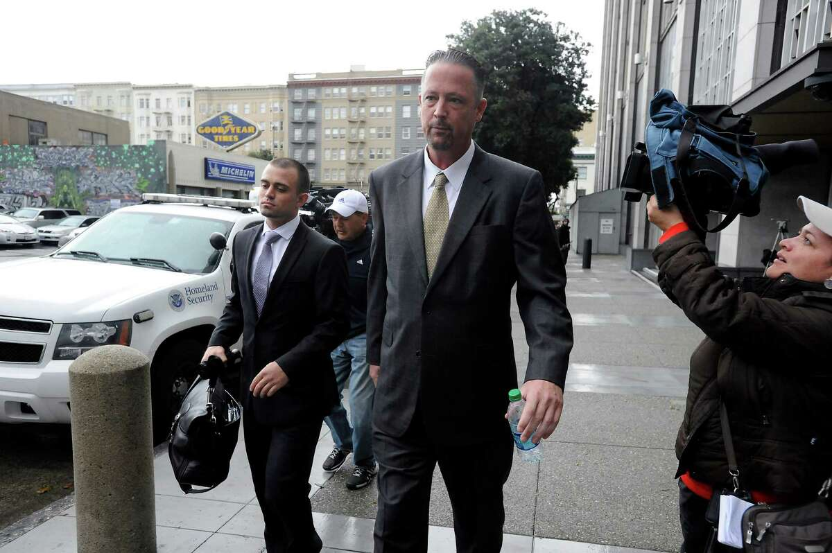 Indicted San Francisco police Officer Ian Furminger (center) leaves the Federal Courthouse after his arraignment in February 2014.