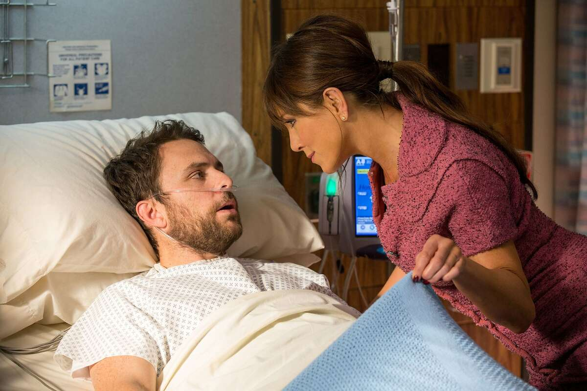 Charlie Day as Dale Arbus and Jennifer Aniston as Dr. Julia Harris, D.D.S. in New Line Cinema's comedy