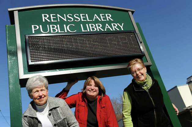 Mary Lou Knox, Friends of the Rensselaer Library president, left, Jane Chirgwin, library director, center, and Michele Pollard-Foley, Friends of the Rensselaer Library vice president, pose with their new sign on Wednesday, Nov. 19, 2014, at Rensselaer Public Library in Rensselaer, N.Y.  (Cindy Schultz / Times Union) Photo: Cindy Schultz / 00029529A
