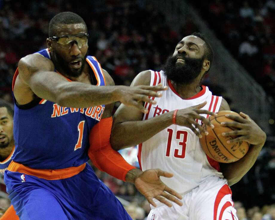 Houston Rockets guard James Harden (13) runs into New York Knicks forward Amar'e Stoudemire (1) during the first half of an NBA basketball game at Toyota Center, Monday, Nov. 24, 2014, in Houston. Photo: Karen Warren, Houston Chronicle / © 2014 Houston Chronicle