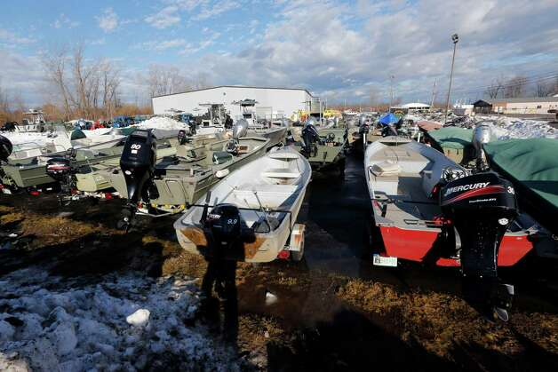 Boats are stored at a state facility, Monday, Nov. 24, 2014, in Alden, N.Y., ahead of potential flooding from melting snow after last week's lake-effect snowstorms. (AP Photo/Mike Groll) ORG XMIT: NYMG101 Photo: Mike Groll / AP
