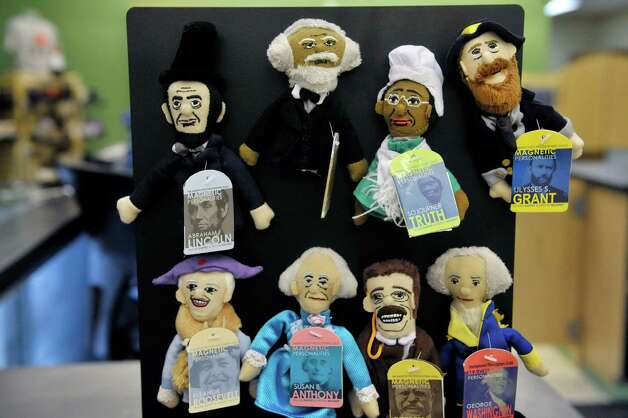 Finger puppets of historical figures  are seen on display in the new Empire State Plaza Visitor Center on Monday, Nov. 24, 2014, in Albany, N.Y.  The new center will be the place for people to shop for gifts, to get visitor information and to get information on tours of the Capitol or tours of the executive mansion.  (Paul Buckowski / Times Union) Photo: Paul Buckowski / 00029616A
