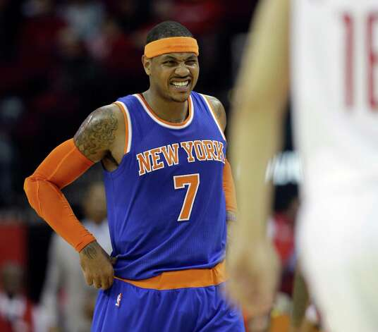 New York Knicks' Carmelo Anthony grimaces as he walks toward his bench during the second quarter of an NBA basketball game against the Houston Rockets Monday, Nov. 24, 2014, in Houston. Anthony had to leave the game. (AP Photo/David J. Phillip) ORG XMIT: HTR111 Photo: David J. Phillip / AP