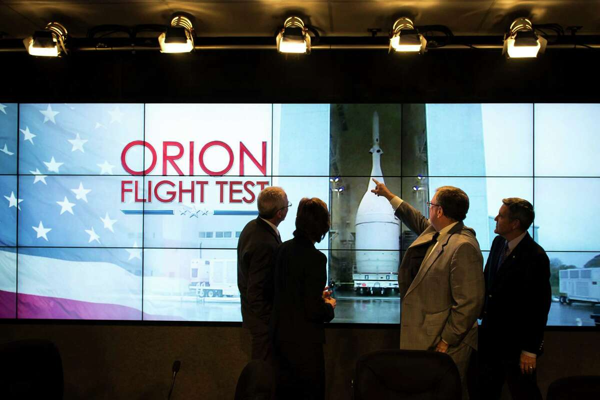 From left, Mark Geyer, Orion Program manager, Ellen Ochoa, Johnson Space Center director, Mike Hawes, Lockheed Martin Space Systems Company director of Human Space Flight Program, and Robert Cabana, Kennedy Space Center director, chat following a press conference before rollout of the Orion spacecraft in preparation for Exploration Flight Test 1 (EFT-1) on Monday, Nov. 10, 2014, at the Kennedy Space Center.