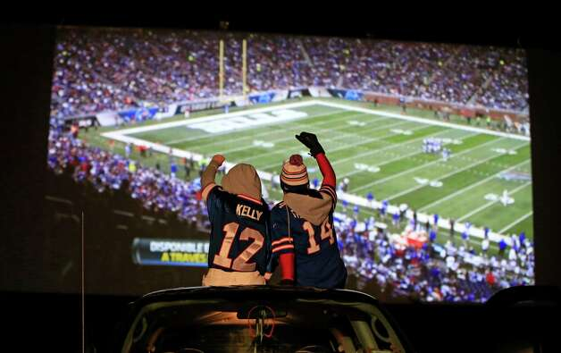 Bills Fans Lina Szwed and Trisha John watch the Buffalo Bills and the New York Jets play at the Transit Drive-In in Lockport, NY on.Monday, Nov. 24, 2014.  The game scheduled to be played in Buffalo had to be moved to Detroit because of snow   (AP Photo/The Buffalo News,  Harry Scull )  TV OUT; MAGS OUT; MANDATORY CREDIT; BATAVIA DAILY NEWS OUT; DUNKIRK OBSERVER OUT; JAMESTOWN POST-JOURNAL OUT; LOCKPORT UNION-SUN JOURNAL OUT; NIAGARA GAZETTE OUT; OLEAN TIMES-HERALD OUT; SALAMANCA PRESS OUT; TONAWANDA NEWS OUT   ORG XMIT: NYBUE131 Photo: Harry Scull Jr. / The Buffalo News