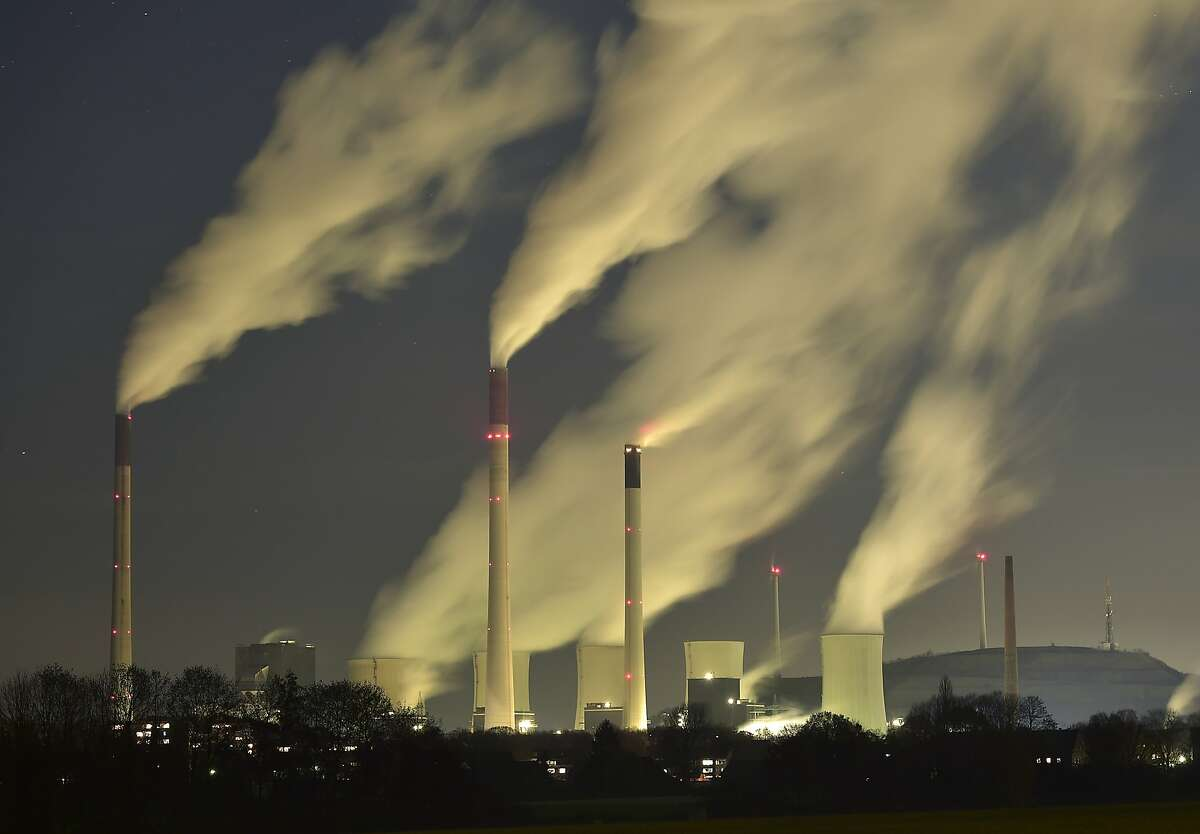 Smoke streams from the chimneys of the E.ON coal-fired power station in Gelsenkirchen, Germany, Monday night, Nov. 24, 2014, and with a capacity of around 2300 MW of power it is one of the most powerful coal-fired power stations in Europe. Coal power plants are under pressure due to the German targets for reducing carbon-dioxide emissions. (AP Photo/Martin Meissner)
