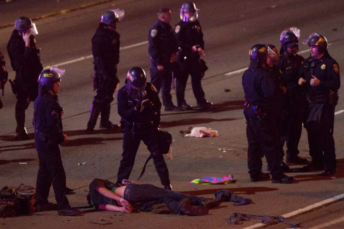 Several Demonstrators were arrested after resisting being forced off the I-580 in Oakland by riot police after they blocked traffic on Nov. 24, 2014 after the announcement that a grand jury in Missouri had decided not to indict a police officer in the killing of unarmed teenager Michael Brown.