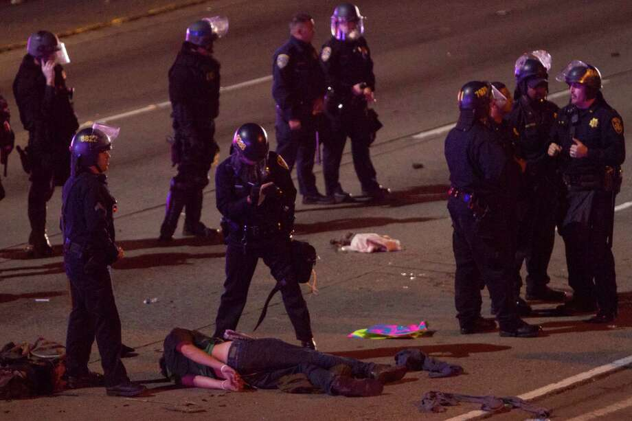 Several Demonstrators were arrested after resisting being forced off the I-580 in Oakland by riot police after they blocked traffic on Nov. 24, 2014 after the announcement that a grand jury in Missouri had decided not to indict a police officer in the killing of unarmed teenager Michael Brown. Photo: SF Gate / Douglas Zimmerman