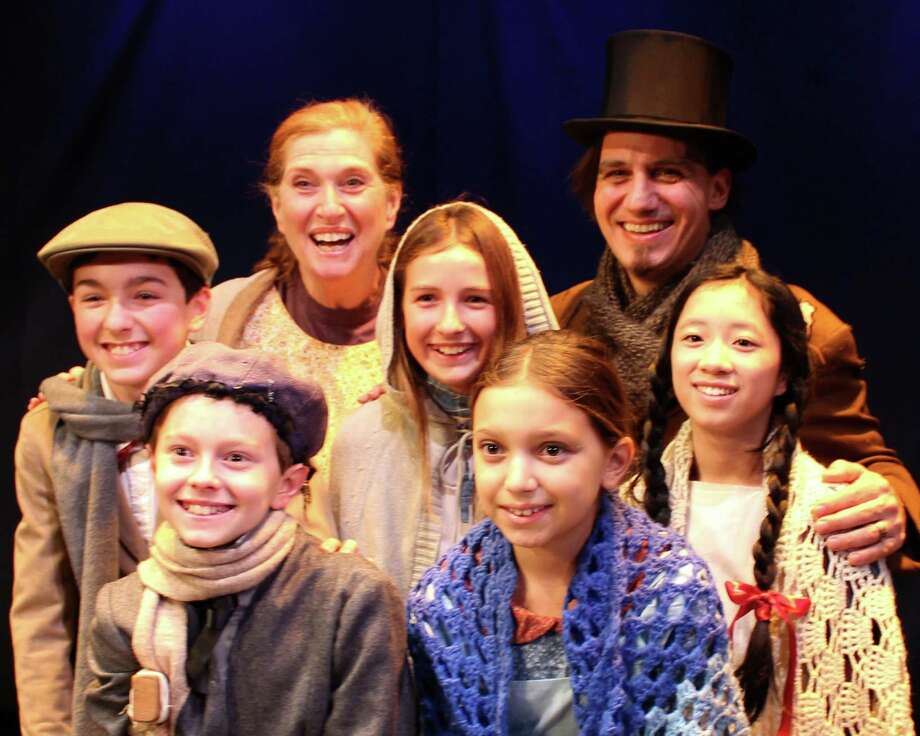 The Cratchit Family from the musical âÄúSCROOGE!âÄù which the Town Players of New Canaan will perform between Dec. 5 and 14 at the Powerhouse Theater in Waveny Park, New Canaan, Conn. Front row: William Haddad and Alyssa Marcella. Middle row: Evan Smolin, Fiona Stevens and Juliette Nicoloro. Back row: Janice Rudolph and Joseph Re. Photo: Contributed Photo, Contributed / New Canaan News Contributed