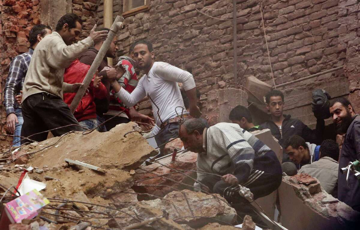 Egyptian volunteers search for survivors in the rubble of a building that collapsed in the Cairo suburb of Matariya, early Tuesday, Nov. 25, 2014. Police officials say several people were killed. Building collapses are common in Egypt, where shoddy construction is widespread in shantytowns, poor city neighbourhoods and rural areas.