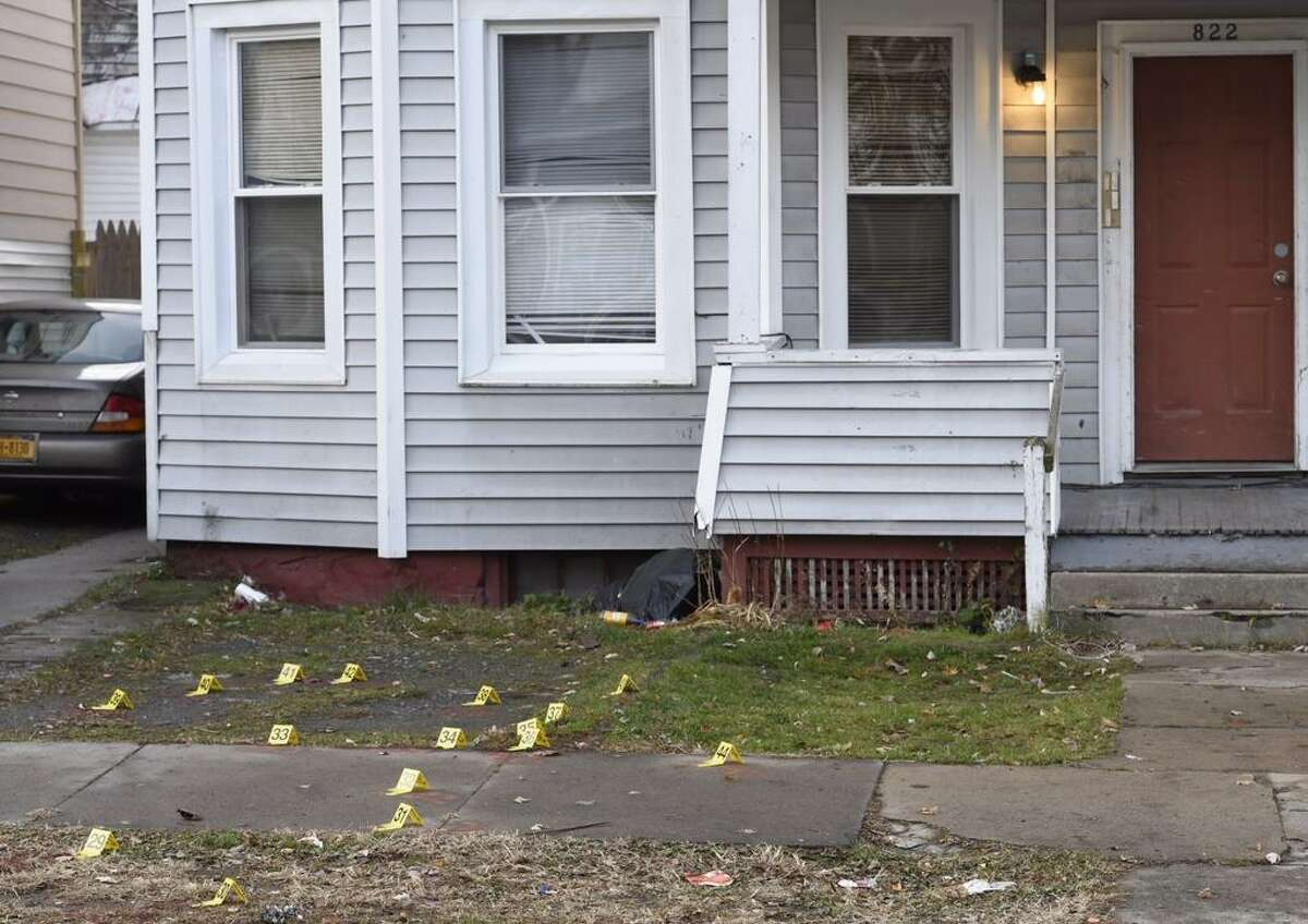 Evidence markers cover the ground and sidewalk on Bridge Street in Schenectady Tuesday, Nov. 25, 2014, the day after a man was shot dead and another gravely injured in a stabbing on the Mont Pleasant Street. (Skip Dickstein / Times Union)